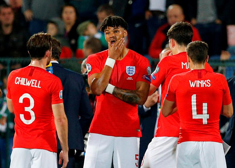 Soccer Football - Euro 2020 Qualifier - Group A - Bulgaria v England - Vasil Levski National Stadium, Sofia, Bulgaria - October 14, 2019 England's Tyrone Mings and teammates as the match is temporarily stopped during the first half REUTERS/Anton Uzunov