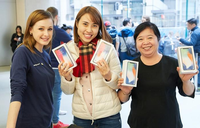 Customers buying iPhones at an Apple Store.