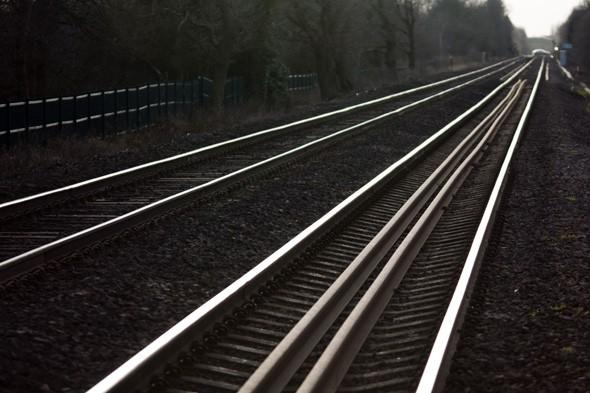 Woman chases train for a MILE along tracks after leaving belongings on board