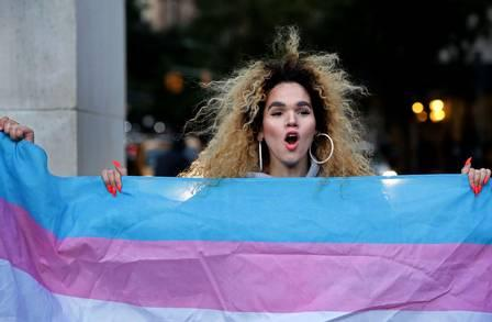 79473672_NEW YORK NY - OCTOBER 21 Morgin Dupont 25 a woman of trans experience holds up the flag.jpg