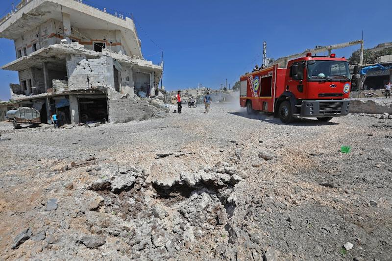 A picture taken on September 4, 2018 shows a fire engine driving on a damaged road after a reported Russian air strike in the rebel-hold town of Muhambal, about 30 kilometres southwest of the city of Idlib (AFP Photo/OMAR HAJ KADOUR)