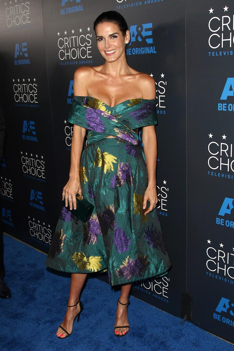 In a printed off-the-shoulder midi dress with a small stomach cut out, Angie Harmon's Christian Siriano dress combined all the top trends of the season.