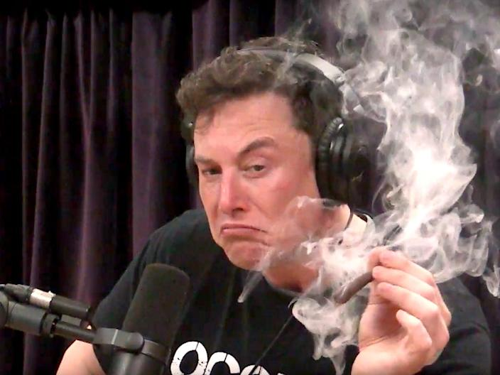 Elon Musk smokes during an interview on the Joe Rogan podcast in September 2018.