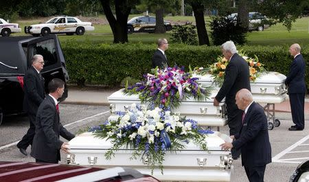 Three caskets are lined up to be put into hearses after the funeral service for members of the Stay family at the Church of Jesus Christ of Latter-Day Saints in Spring, Texas July 16, 2014. REUTERS/Daniel Kramer