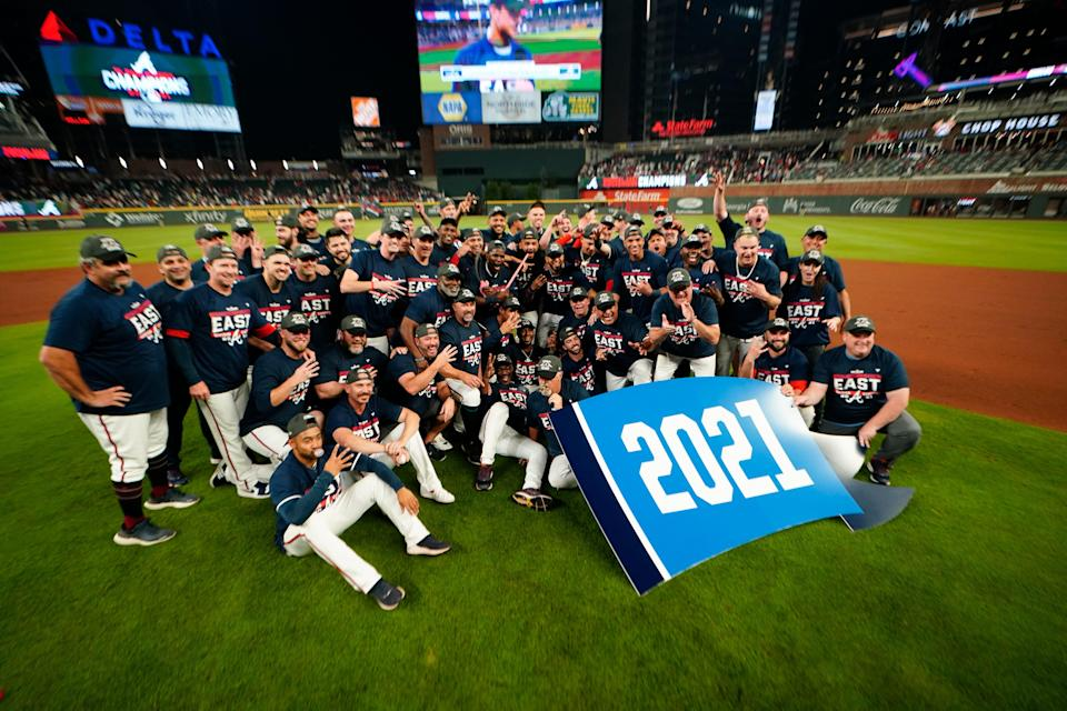 The Atlanta Braves pose for a team photo after clinching the NL East crown.