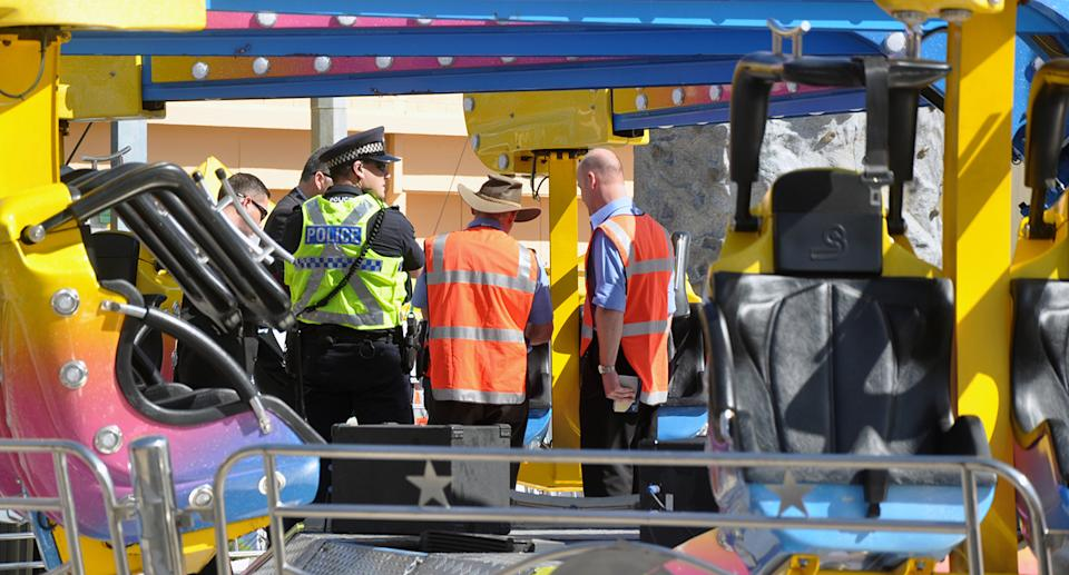 Police and safety officers inspect the Airmaxx 360 ride at the Royal Adelaide Show in Adelaide.