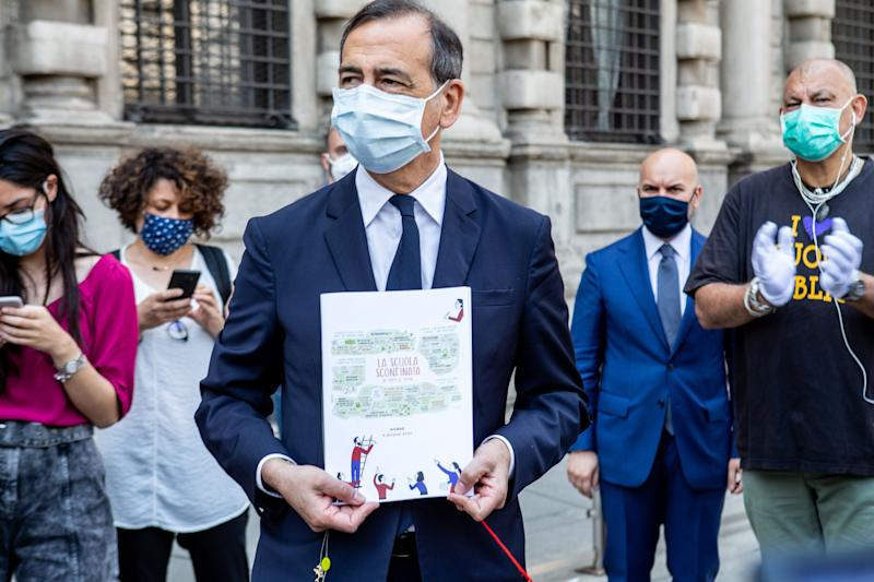 "MILAN, ITALY - JUNE 02: The Major of Milan Beppe Sala receives the ""La Scuola Sconfinata"" project at the end of the the flash mob in support of greater funding for the public school and its pupils after the coronavirus crisis on June 02, 2020 in Milan, Italy. Schools in the country remain closed, whilst many businesses continue to reopen after more than two months of a nationwide lockdown meant to curb the spread of Covid-19. (Photo by Roberto Finizio/Getty Images) (Photo: Roberto Finizio via Getty Images)"