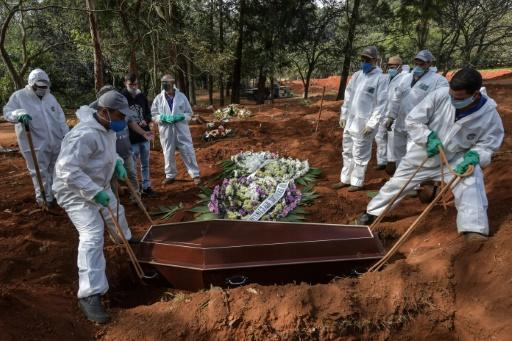 Brazilian grave diggers at the Vila Formosa cemetery on the outskirts of Sao Paulo say it is hard to keep up with their work