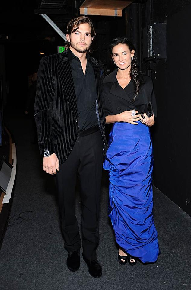 """Ashton Kutcher and Demi Moore were all smiles at the 2011 Costume Designers Guild Awards, held at the Beverly Hills Hilton hotel on Tuesday night. While Kutcher sported a funky pinstripe blazer, his wife glowed in a cobalt blue Vivienne Westwood dress, which she accessorized with over $360,000 of Cartier jewels! Stefanie Keenan/<a href=""""http://www.gettyimages.com/"""" target=""""new"""">GettyImages.com</a> - February 22, 2011"""