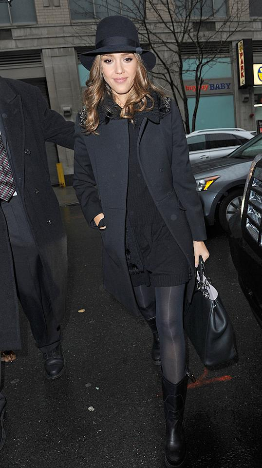 Jess opted for warmth over style while arriving at -- sigh -- <em>another</em> interview in her third look of the day. She covered her combination of an LBD, opaque black tights, and boots with a dark coat and hat. (01/17/2012)