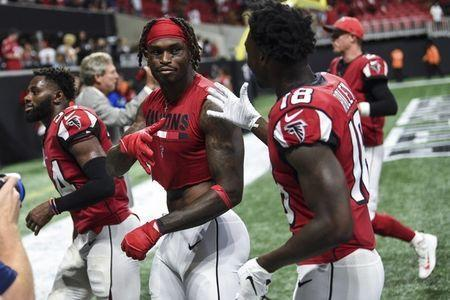 Sep 16, 2018; Atlanta, GA, USA; Atlanta Falcons wide receiver Julio Jones (left) and wide receiver Calvin Ridley (18) react on their way off the field after defeating the Carolina Panthers at Mercedes-Benz Stadium. Mandatory Credit: Dale Zanine-USA TODAY Sports