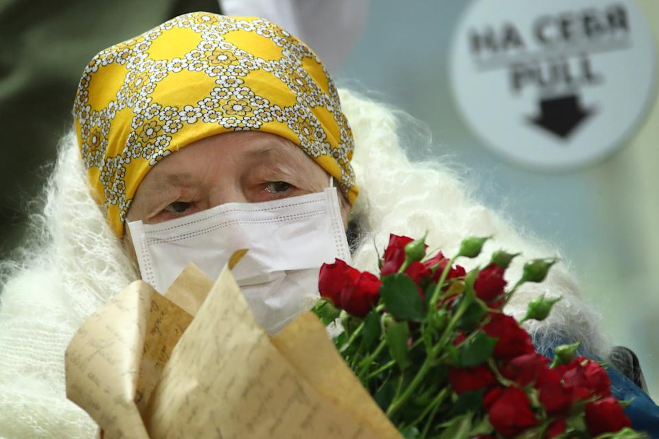 MOSCOW, RUSSIA - MAY 13, 2020: 100-year-old Pelageya Poyarkova being discharged from an infectious diseases facility of the Federal Brain and Neurotechnologies Center of the Russian Federal Medical Biological Agency (FMBA) as she has recovered from the COVID-19 disease. Valery Sharifulin/TASS (Photo by Valery Sharifulin\TASS via Getty Images)