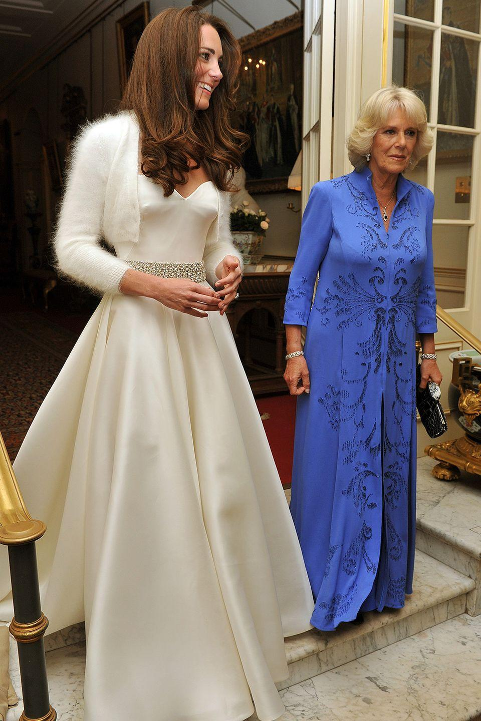 """<p>Because if you're royalty, you can have as many wedding dresses as you want. The new Duchess of Cambridge changed into a simpler white satin dress for her wedding reception, complete with an elegant beaded belt and angora cardigan. </p><p><strong>RELATED</strong>: <a href=""""https://www.goodhousekeeping.com/beauty/fashion/g4690/kate-middleton-wedding-dress/"""" rel=""""nofollow noopener"""" target=""""_blank"""" data-ylk=""""slk:The 10 Hidden Details in Kate Middleton's Wedding Dress You Totally Missed"""" class=""""link rapid-noclick-resp"""">The 10 Hidden Details in Kate Middleton's Wedding Dress You Totally Missed</a></p>"""