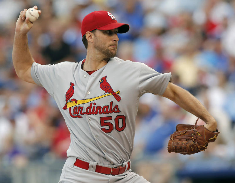 Cardinals bounce back, beat Royals 5-2 in 11