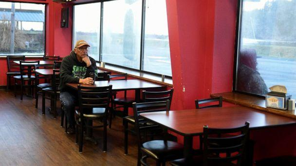 PHOTO: A man sits in the restaurant area of a gas station at Quinault Indian Nation's main village, on the Quinault Indian Reservation in Taholah, Wash. March 6, 2020. (Stephanie Keith/Reuters, FILE)