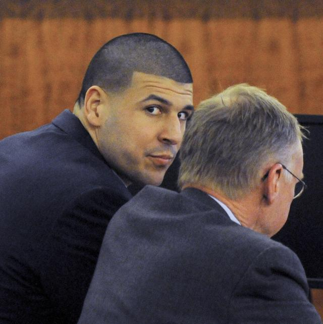 Former tight end for the New England Patriots Aaron Hernandez (L) sits with his attorney Charles Rankin during his trial at the Bristol County Superior Court in Fall River, Massachusetts April 13, 2015. The jury in the murder trial of former National Football League player Aaron Hernandez began its fifth day of deliberations on Monday over whether he is guilty of killing an acquaintance in 2013, in the first of two murder trials he will face this year. REUTERS/Ted Fitzgerald/Pool