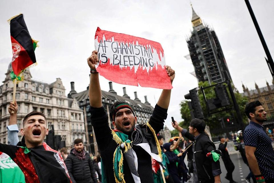 Afghanistan flags were waved while others wore the country's colours green, red and black at the demonstration (AFP via Getty Images)