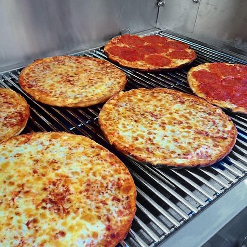 <p>In 1947, World War II veteran E. James Jamoulis bought the Cape Cod Cafe in Brockton, MA. He served up these no-frills <span> Cape Cod Cafe Pizza Bar Pizzas</span> ($89 for four) that have been famous on the East Coast for decades.</p>