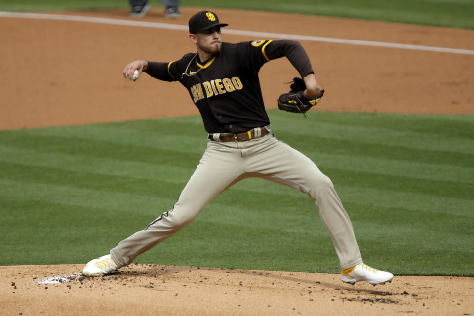San Diego Padres starting pitcher Joe Musgrove throws to a Los Angeles Dodgers batter during the first inning of a baseball game in Los Angeles, Sunday, April 25, 2021. (AP Photo/Alex Gallardo)