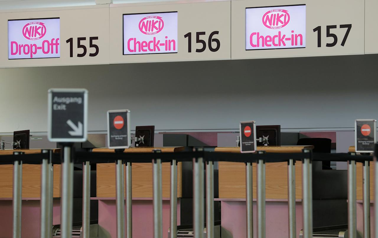 Empty Niki check-in counters are seen at Vienna International Airport in Schwechat, Austria December 14, 2017.  REUTERS/Heinz-Peter Bader