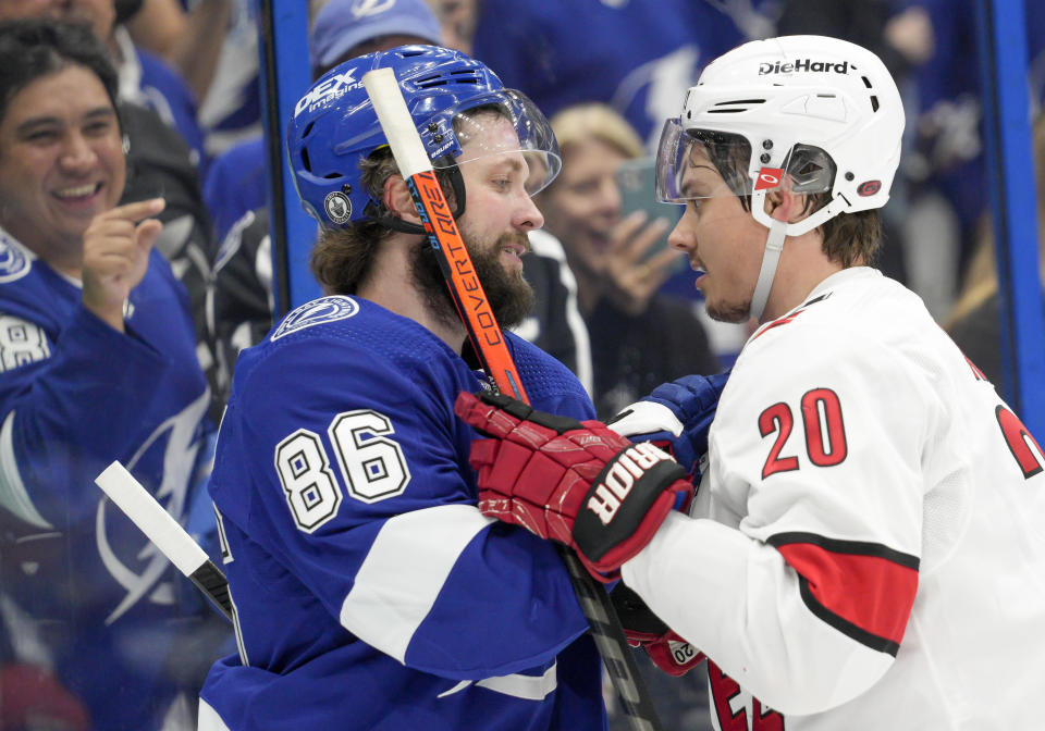 TAMPA, FL - JUNE 03: Tampa Bay Lightning right wing Nikita Kucherov (86) and Carolina Hurricanes right wing Sebastian Aho (20) have words during the NHL Hockey 2nd round Stanley Cup match between the Tampa Bay Lightning and Carolina Hurricanes on June 3, 2021 at Amalie Arena in Tampa, FL. (Photo by Andrew Bershaw/Icon Sportswire via Getty Images)