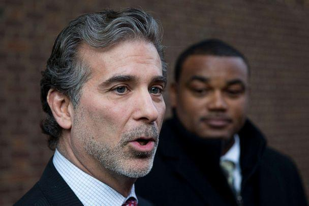 PHOTO: Co-lead players' lawyer Christopher Seeger, left, and client former NFL player Shawn Wooden speak with members of the media after a hearing on the proposed NFL concussion settlement outside of the U.S. Courthouse in Philadelphia, Nov. 19, 2014. (Matt Rourke/AP, FILE)