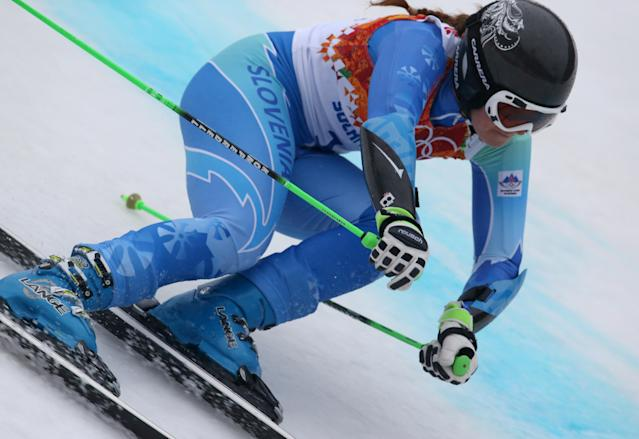 Slovenia's Tina Maze makes a turn in the second run of the women's giant slalom to win the gold medal at the Sochi 2014 Winter Olympics, Tuesday, Feb. 18, 2014, in Krasnaya Polyana, Russia. (AP Photo/Alessandro Trovati)