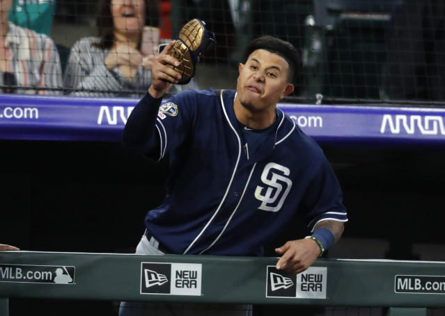 San Diego Padres' Manny Machado yells at home plate umpire Bill Welke, who had called Machado out on strikes during the fifth inning of the team's baseball game against the Colorado Rockies on Saturday, June 15, 2019, in Denver. (AP Photo/David Zalubowski)