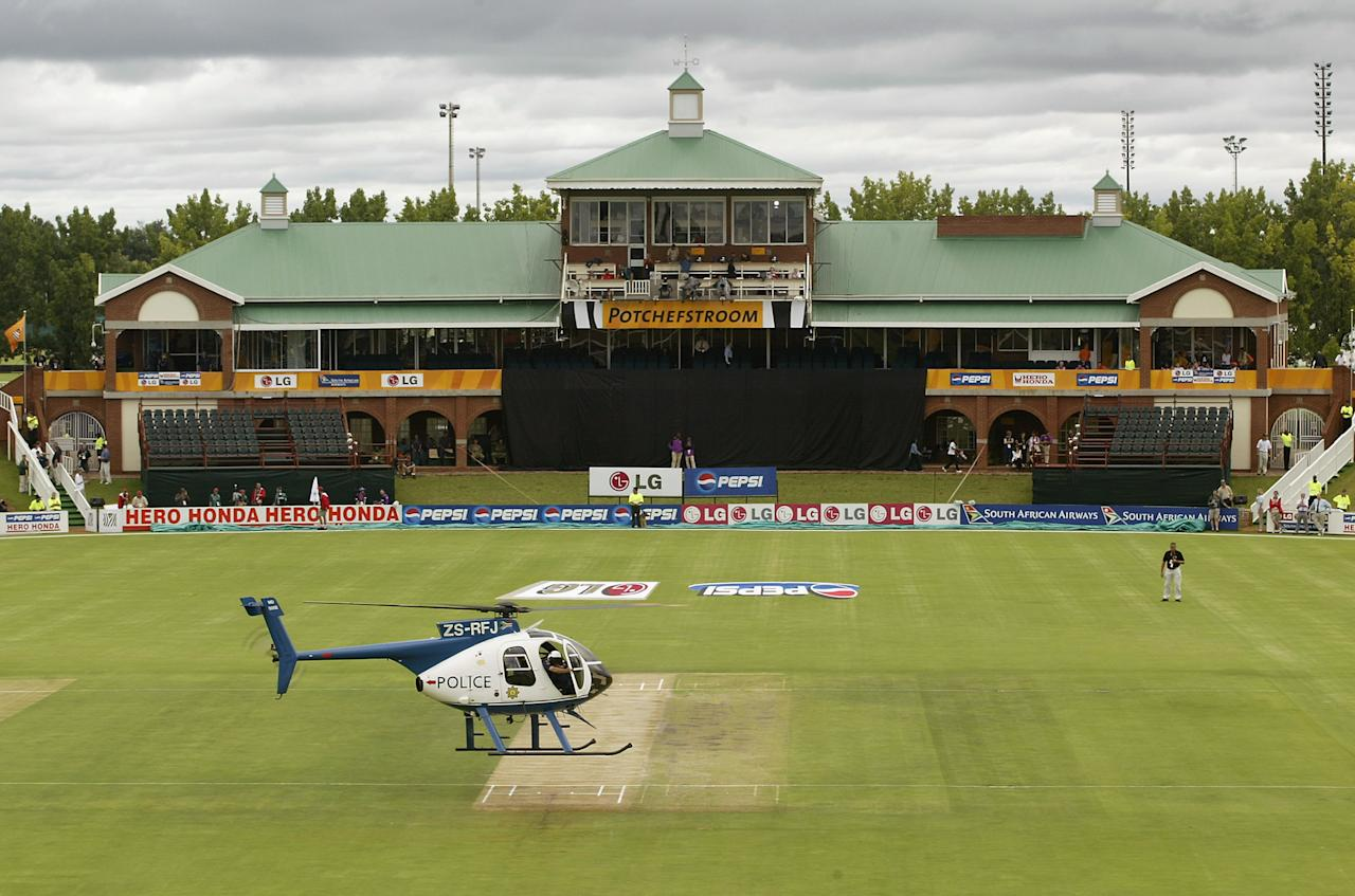 POTCHEFSTROOM - FEBRUARY 20:  A police helicopter attempts to dry the pitch during the ICC Cricket World Cup 2003 Pool A match between Australia and Holland held on February 20, 2003 at the North West Cricket Stadium, in Potchefstroom, South Africa. Australia won the match by 75 runs. (Photo by Hamish Blair/Getty Images)