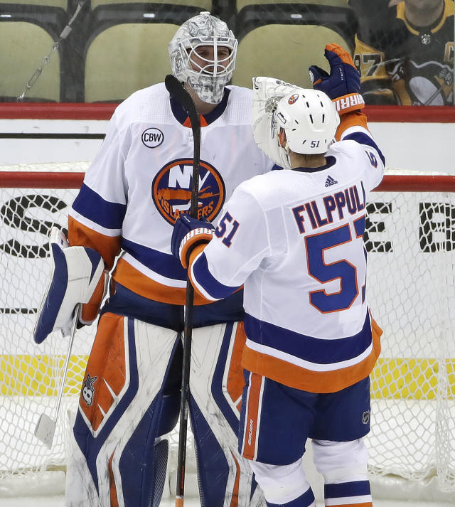 New York Islanders goaltender Robin Lehner (40) celebrates with Valtteri Filppula at the end of Game 4 of the team's NHL hockey first-round playoff series against the Pittsburgh Penguins in Pittsburgh, Tuesday, April 16, 2019. The Islanders won 3-1, and swept the series. (AP Photo/Gene J. Puskar)