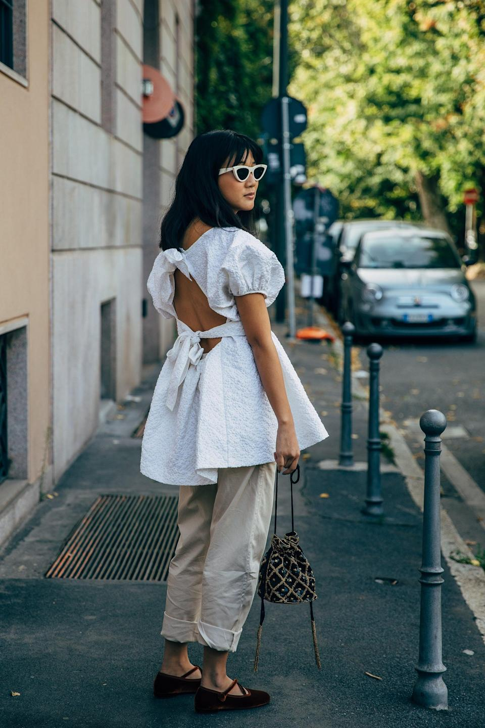 <p>Play opposites with tailored trousers and a floaty, open-back dress to top it off. </p>