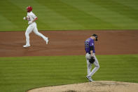 Colorado Rockies starting pitcher Austin Gomber (26) walks around the mound as St. Louis Cardinals' Jack Flaherty rounds the bases after hitting a solo home run during the third inning of a baseball game Friday, May 7, 2021, in St. Louis. (AP Photo/Jeff Roberson)