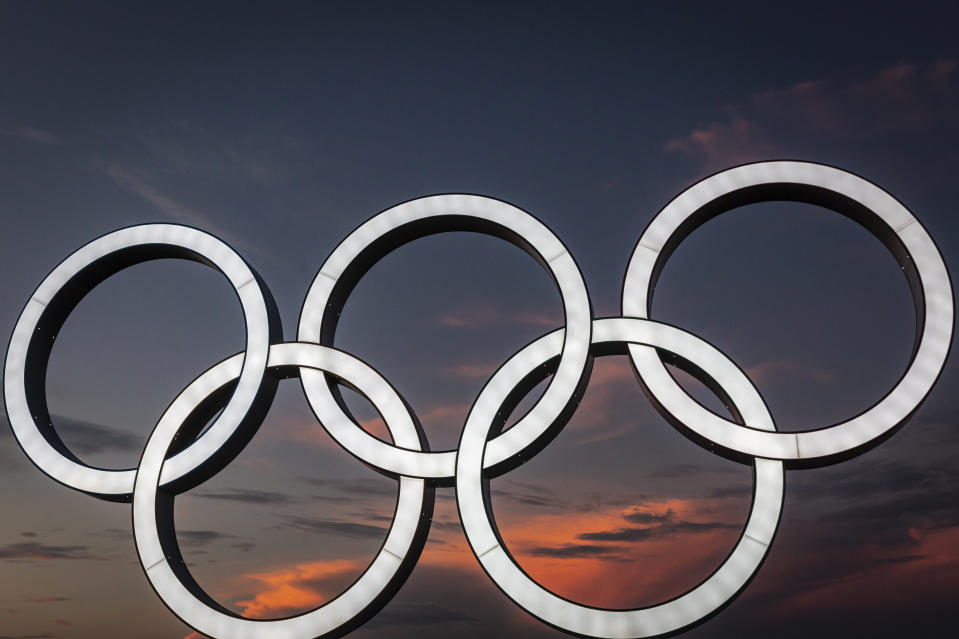 YOKOHAMA, JAPAN - JULY 22: Olympics rings are seen at sunset on July 22, 2021 in Yokohama, Japan. Olympics opening ceremony director, Kentaro Kobayashi, has been sacked on the eve of the event after footage emerged in which he appeared to make jokes about the Holocaust. Mr Kobayashi follows a number of other figures involved in the Tokyo Olympic Games who have had to step down for inappropriate remarks. (Photo by Yuichi Yamazaki/Getty Images)