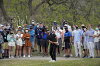Dustin Johnson hits his third shot on the 16th hole during a first round match at the Dell Technologies Match Play Championship golf tournament Wednesday, March 24, 2021, in Austin, Texas. (AP Photo/David J. Phillip)