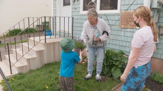 Many people have stopped by to give plants to Shepard to replace the ones that were stolen from her yard.