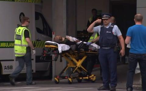 Victim arriving at hospital in Christchurch following the shootings - Credit: AFP
