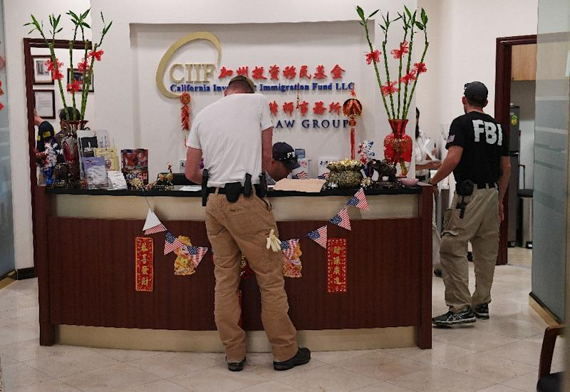 FBI agents search the offices of the California Investment Immigration Fund during an investigation into an alleged US$50 million high-end visa fraud scheme involving as many as 100 Chinese nationals in San Gabriel (AFP Photo/Mark RALSTON)