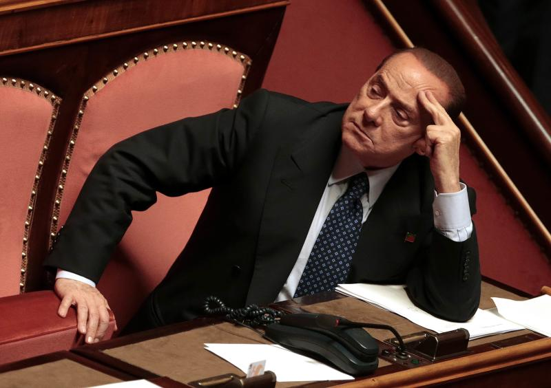 File photo of Italian centre-right leader Berlusconi looking on at the Senate in Rome