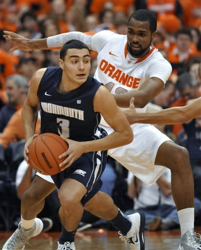 Syracuse's James Southerland defends against Monmouth's Max DiLeo during the first half of an NCAA college basketball game in Syracuse, N.Y., Saturday, Dec. 8, 2012. (AP Photo/Kevin Rivoli)