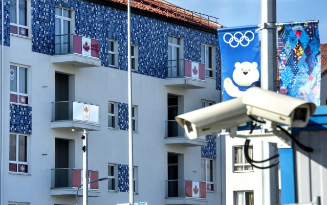 Security cameras are seen along the Canadian section of the athlete's village at the Sochi Winter Olympics, Tuesday, Feb. 4, 2014, in Sochi, Russia. (AP Photo/The Canadian Press, Paul Chiasson)