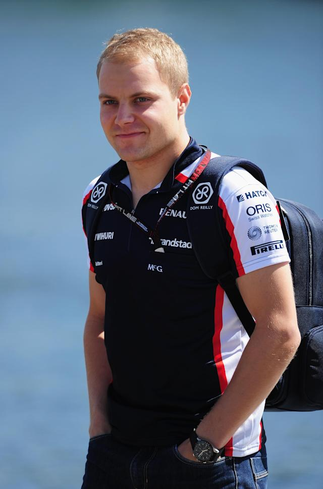MONTREAL, QC - JUNE 09: Valtteri Bottas of Finland and Williams arrives in the paddock before the Canadian Formula One Grand Prix at the Circuit Gilles Villeneuve on June 9, 2013 in Montreal, Canada. (Photo by Shaun Botterill/Getty Images)