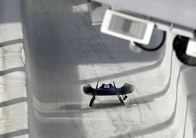 FILE - In this Friday, Feb. 12, 2010 file photo, the sled belonging to Nodar Kumaritashvili of Georgia sits empty on the track just after he crashed during a training run for the men's singles luge at the Vancouver 2010 Olympics in Whistler, British Columbia, Canada. Kumaritashvili died when he lost control of his sled at nearly 145 kph (90 mph), flew off course and slammed into a steel pole. The horrifying death of Kumaritashvili cast a pall over the Vancouver Games, raised questions about track safety and design and changed Olympic luge forever. (AP Photo/Michael Sohn, File)