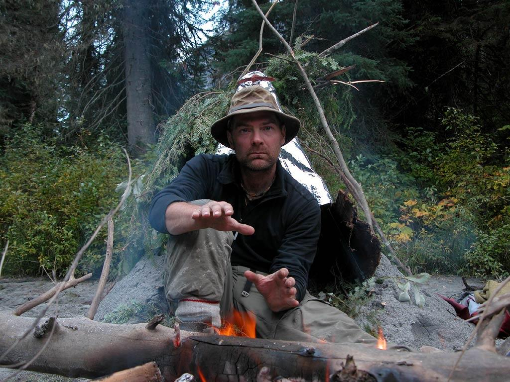 Host Les Stroud makes a fire at camping site as seen on Survivorman.