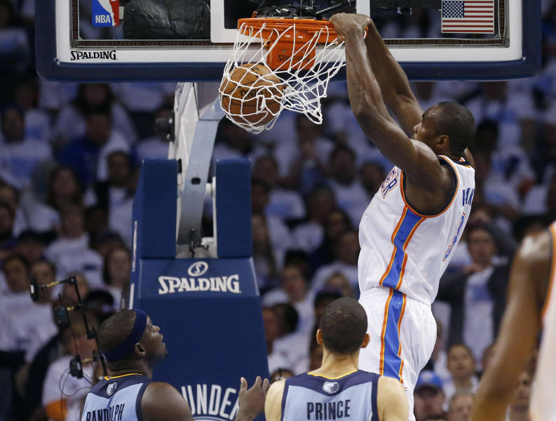 Oklahoma City Thunder forward Serge Ibaka, right, dunks in front of Memphis Grizzlies forward Zach Randolph, left, and forward Tayshaun Prince in the second quarter of Game 5 of an opening-round NBA basketball playoff series in Oklahoma City, Tuesday, April 29, 2014. (AP Photo)