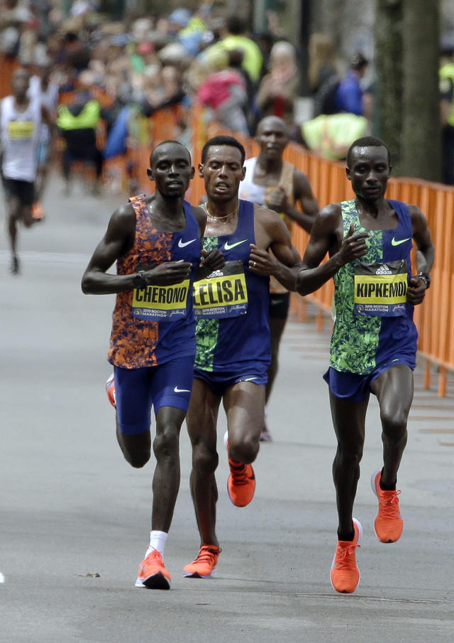 Lawrence Cherono, left, of Kenya, Lelisa Desisa, of Ethiopia, center, and Kenneth Kipkemoi, right, of Kenya, run the course during the 123rd Boston Marathon on Monday, April 15, 2019, in Brookline, Mass.. (AP Photo/Steven Senne)