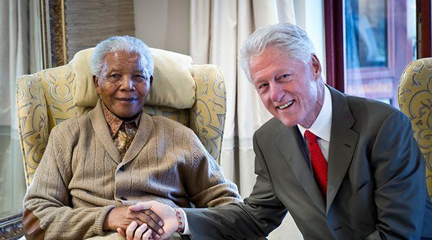 In this handout provided by the Clinton Foundation, former U.S. President Bill Clinton poses with former South African President Nelson Mandela on the eve of his 94th birthday at his residence July 17, 2012 in Qunu, South Africa. Photo: Getty Images