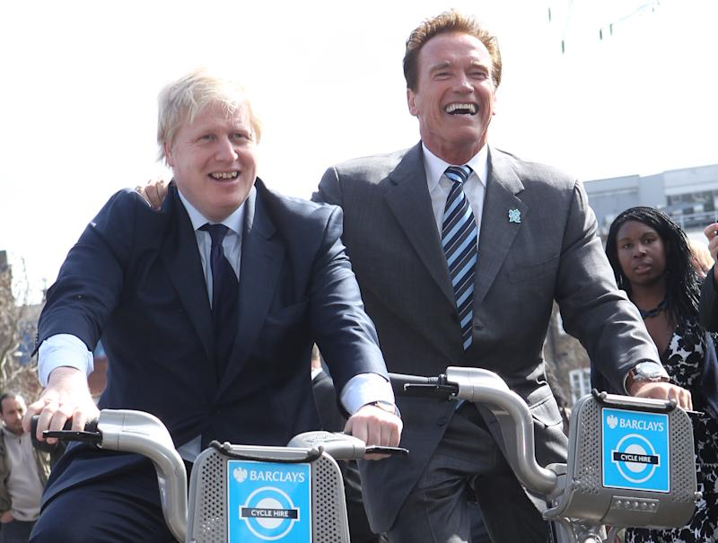 LONDON, UNITED KINGDOM - MARCH 31: Mayor of London Boris Johnson (L) poses on London Cycle Hire bikes with former Governor of California Arnold Schwarzenegger in front of City Hall on March 31, 2011 in London, England. Mr Johnson has today met with Mr Schwarzenegger to exchange ideas on how to encourage low and zero emission technologies. (Photo by Fred Duval/Getty Images)