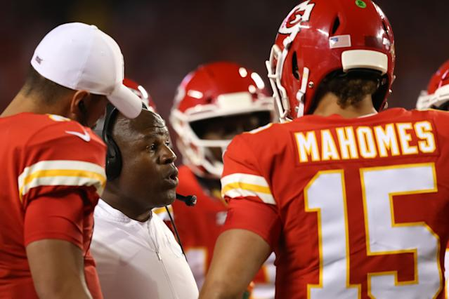 Kansas City Chiefs offensive coordinator Eric Bieniemy in a huddle with quarterbacks Patrick Mahomes and Matt Moore on Oct. 6, 2019 at Arrowhead Stadium in Kansas City, MO. (Scott Winters/Icon Sportswire via Getty Images)