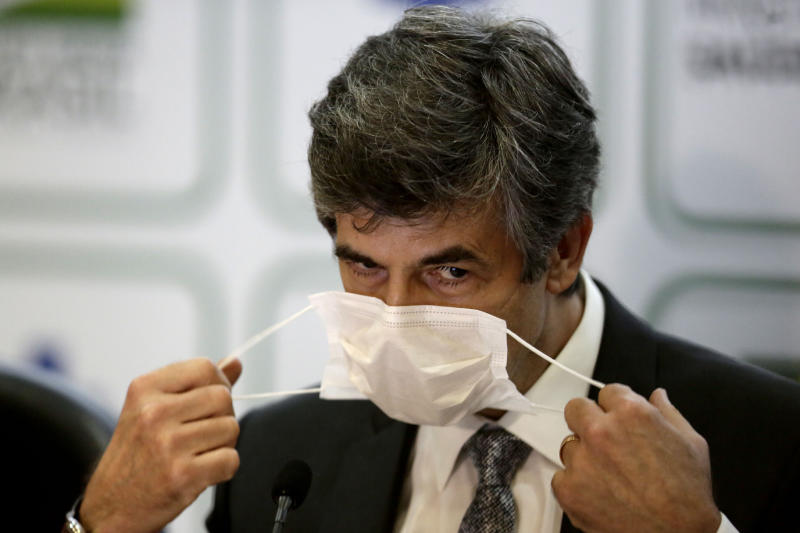 Brazil's outgoing Health Minister Nelson Teich removes his mask to give a news conference at the Health Ministry headquarters in Brasilia, Brazil, Friday, May 15, 2020. Teich resigned on Friday, May 15, after less than a month on the job in a sign of continuing upheaval in the nation's battle with the COVID-19 pandemic and President Jair Bolsonaro's pressure for the nation to prioritize the economy over health-driven lockdowns. (AP Photo/Eraldo Peres)