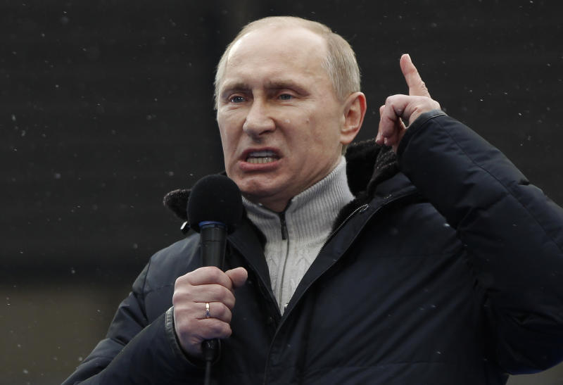 FILE -  In this Thursday, Feb. 23, 2012 file photo, Russian Prime Minister Vladimir Putin gesture while speaking as he attends a massive rally in his support at Luzhniki stadium in Moscow,  Russia. Russian and Ukrainian special services have arrested a group of suspects accused of involvement in a plot to assassinate Prime Minister Vladimir Putin, Russia's state television reported Monday, Feb. 27, 2012. (AP Photo /Alexander Zemlianichenko, file)